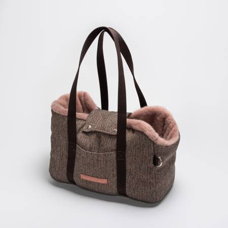 fluffy dog carrier with fishbone fabric and pink inlay