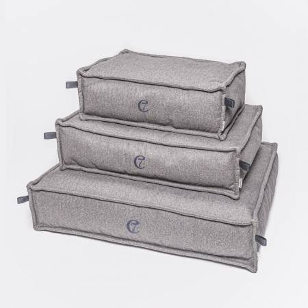 3 light grey dog beds