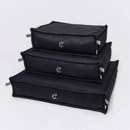 3 dark grey dog beds in different sizes