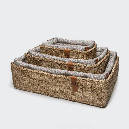 three dog baskets with flower print in different sizes