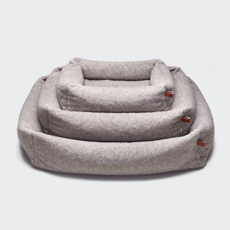 3 dog beds in a natural color made of teddy fabric