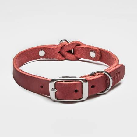 Closed red leather collar with braiding and silver buckle