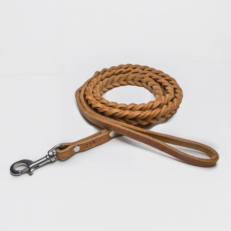 Draped dog leash in light brown braided leather with silver carabiner and hand loop
