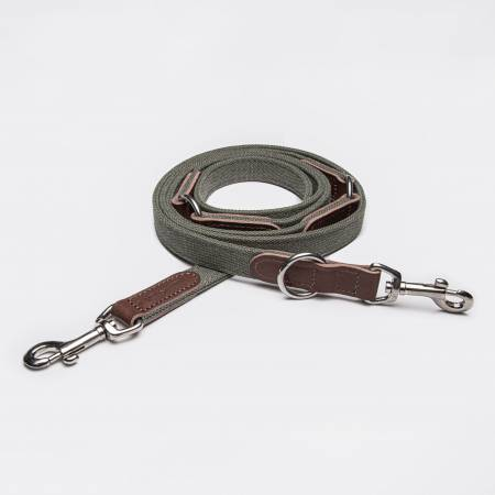 Draped green canvas dog leash with dark brown leather elements and silver closure