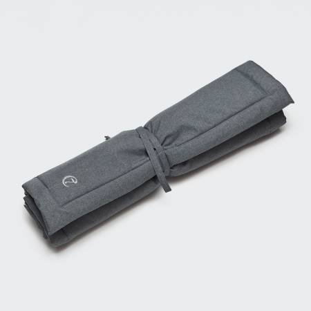 rolled up dark grey water repellent dog mat