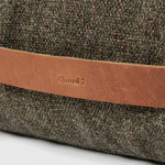 leather handle of a dog bed in olive