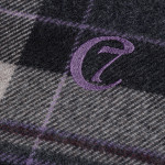 details of a checked dog blanket made of wool