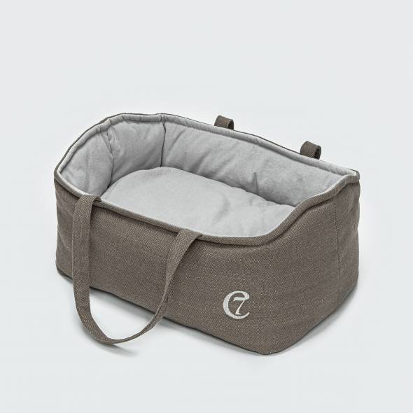 Puppy dog bed with handles and a soft pillow