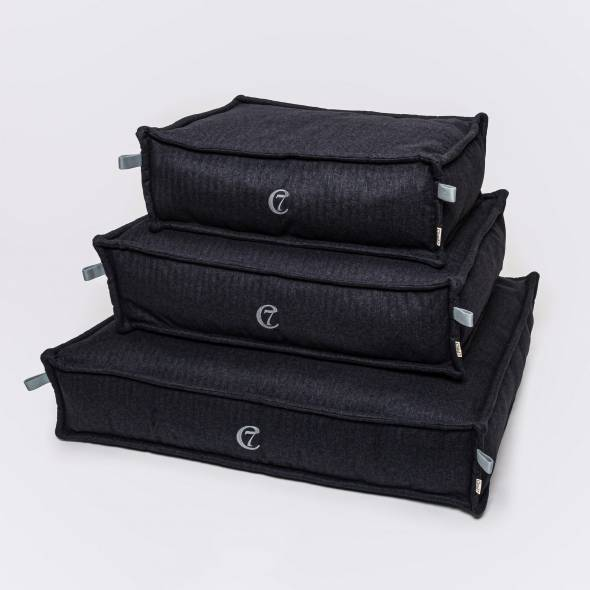3 dark grey dog beds in different sizes
