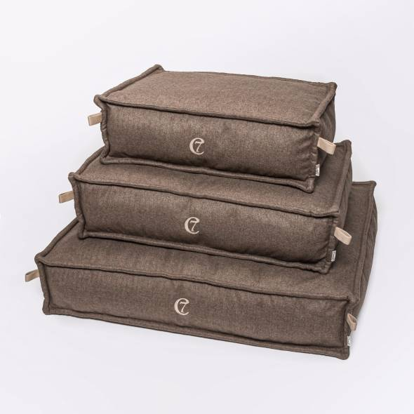 3 light brown dog beds made of fishbone fabric