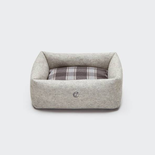 Grey dog bed made of felt with a soft checked pillow