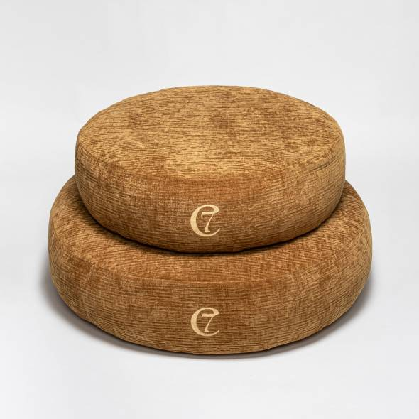two round dog beds in mustard yellow