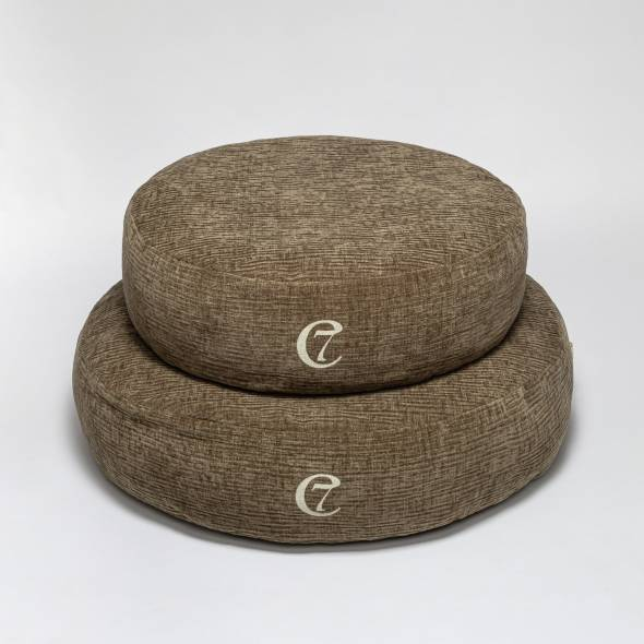 two round dog beds in dark green