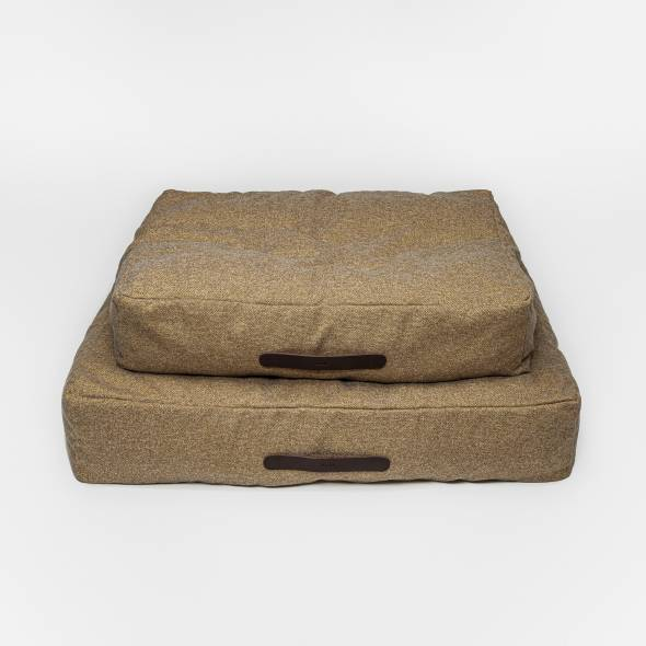 two beige dog beds