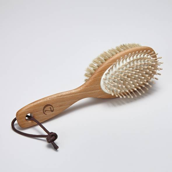 Dog fur brush with leather loop