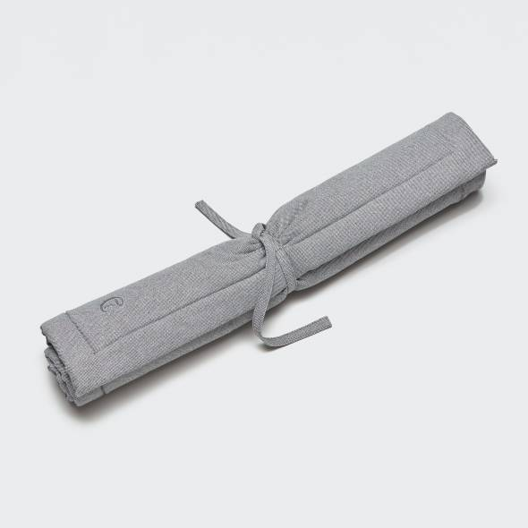 rolled up light grey dog mat