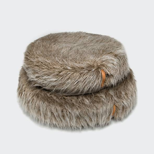 two round and furry and fluffy dog beds in a flokati style
