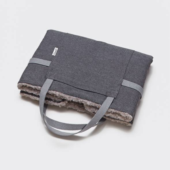 foldable grey travel bed with wool inside